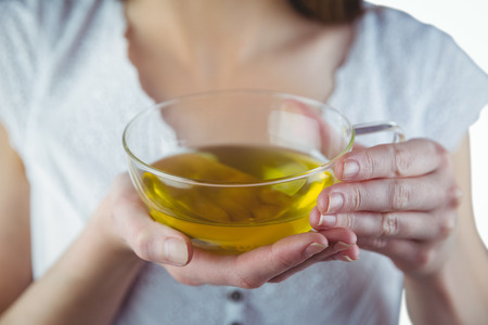 herbal tea: Pretty woman with herbal tea on white background