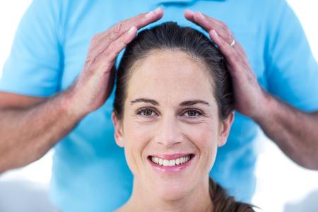 reiki: Portrait of smiling woman getting reiki treatment at home