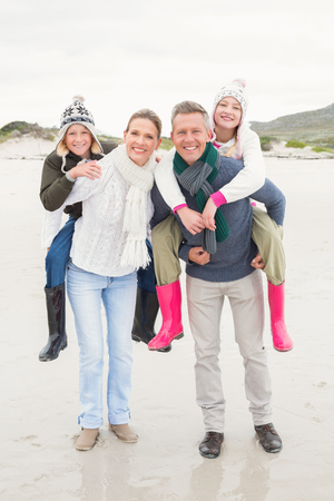 family fun: Happy family enjoying a nice day out at the beach