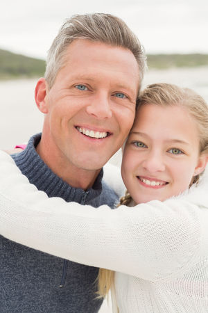 short wave: Father and daughter standing together at the beach
