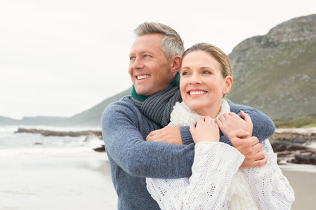 short wave: Cute couple standing and holding each other at the beach Stock Photo