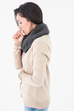 Sick brunette coughing on white background Stock Photo