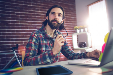 thoughful: Thoughful creative businessman working in office Stock Photo