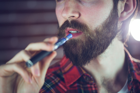 hansome: Close-up of hansome man holding electronic cigarette