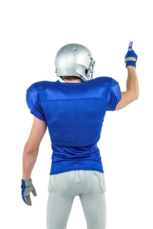 cut the competition: Rear view of sports player pointing against white background Stock Photo