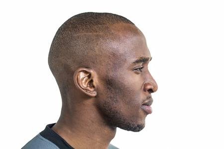 sportsman: Vista de perfil de deportista de confianza contra el fondo blanco Foto de archivo