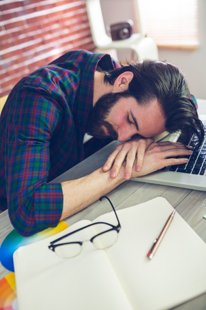 cool guy: Tired creative businessman sleeping in office Stock Photo