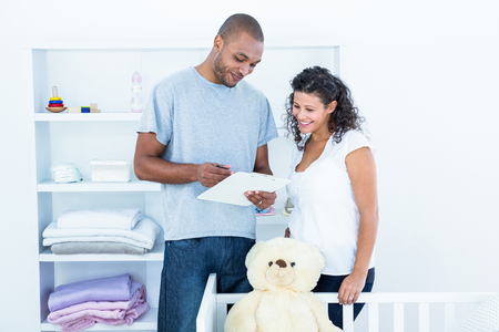paperwork: Happy couple looking at document standing in room Stock Photo
