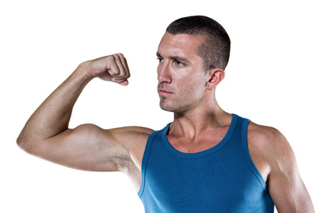 flexing: Handsome man flexing muscles against white background