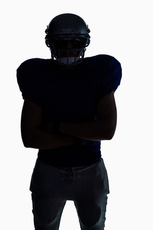 Silhouette American football player standing against white background Stock Photo