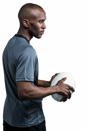 rugbybal: Sportsman holding rugby ball over white background