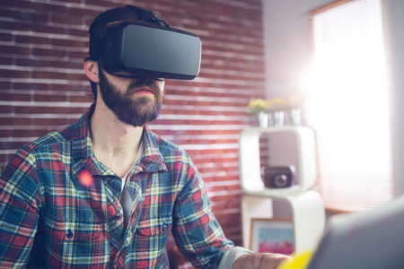 editor: Creative editor wearing 3D video glasses at office