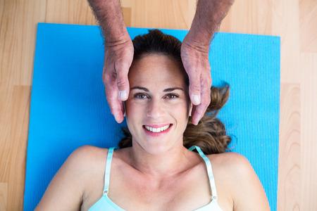 reiki: High angle portrait of smiling pregnant woman getting reiki treatment Stock Photo