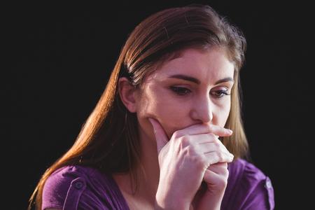desolaci�n: Unhappy woman thinking  on black background Foto de archivo
