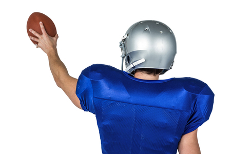 cut the competition: Sports player holding ball against white background