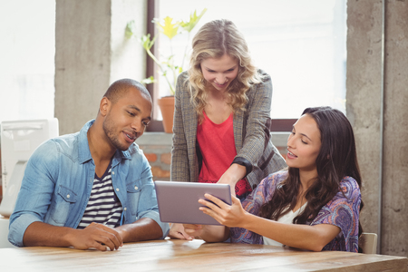 light hair: Discussing over tablet in bright office