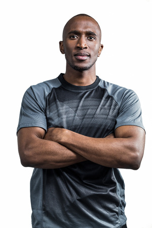 arms crossed: Sportsman with arms crossed standing against white background Stock Photo