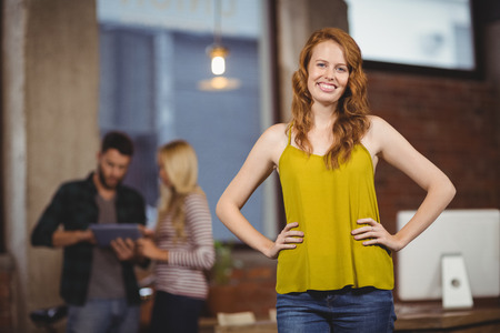 hands on hip: Portrait of young beautiful woman with hands on hip Stock Photo
