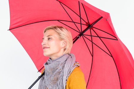 shivering: Happy woman keeping dry under her umbrella