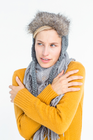 shivering: Attractive blonde wearing a warm hat while shivering
