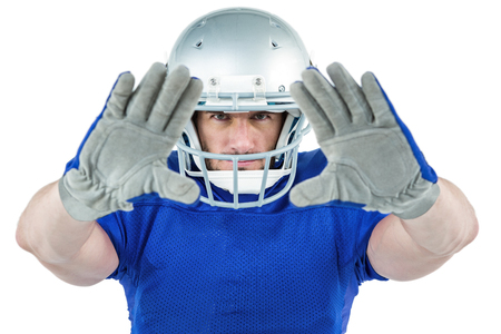 defending: Portrait American football player defending against white background Stock Photo