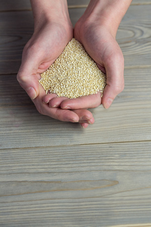 sesame seed: Woman showing handful of sesame seed in close up