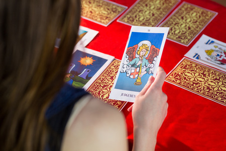 Fortune teller using tarot cards on red table Stock Photo - 45495605