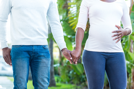 holding hands while walking: Couple holding hands while walking in park Stock Photo
