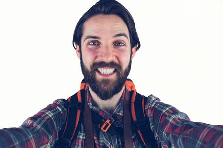 adventuring: Portrait of happy hiker against white background