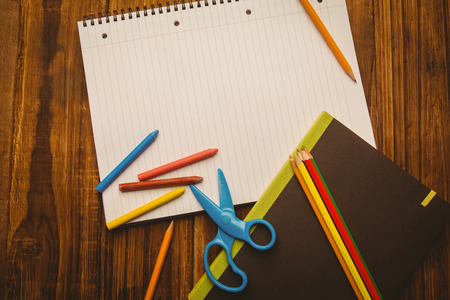crayon  scissors: School supplies on desk with copy space shot in studio