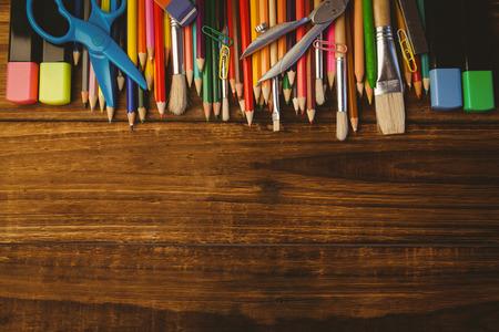 school desk: Art supplies on desk with copy space shot in studio