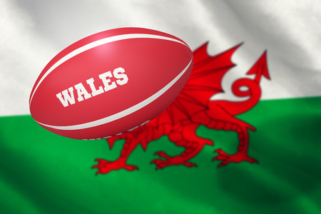 wales: Wales rugby ball against flag of wales Stock Photo