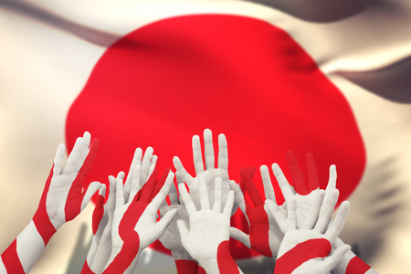 raise the white flag: People raising hands in the air against flag of japan