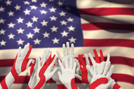 raise the white flag: People raising hands in the air against close-up of american flag