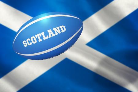 scottish flag: Scozia pallone da rugby contro primo piano della bandiera scozzese Archivio Fotografico