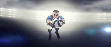 player: Portrait full length of American football player diving against spotlight