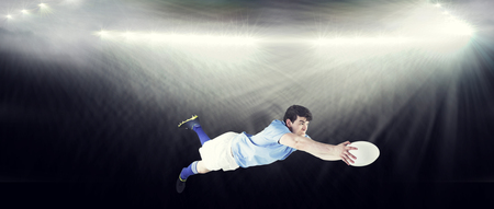 scoring: A rugby player scoring a try against spotlight