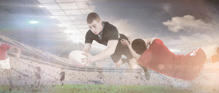 scoring: A rugby player scoring a try against rugby match Stock Photo