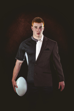 half dressed: Rugby player holding a rugby ball against half a suit