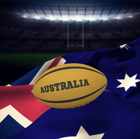 world sport event: Australia rugby ball against rugby stadium Stock Photo