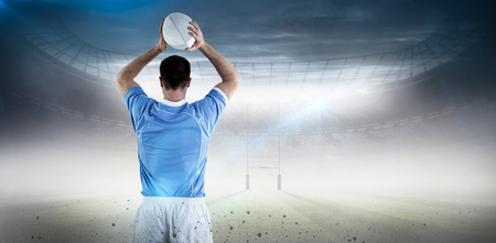 rugby ball: Rugby player about to throw a rugby ball against rugby pitch