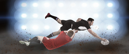 scoring: A rugby player scoring a try against spotlights Stock Photo