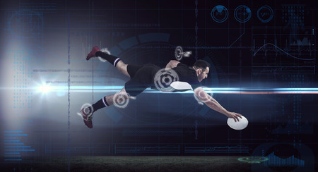 sports clothing: Rugby player scoring a try against fitness interface Stock Photo