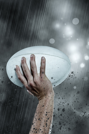 player: Cropped image of sports player holding ball against rain