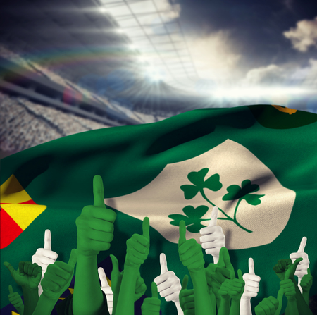 raise the white flag: Hands showing thumbs up against rugby stadium