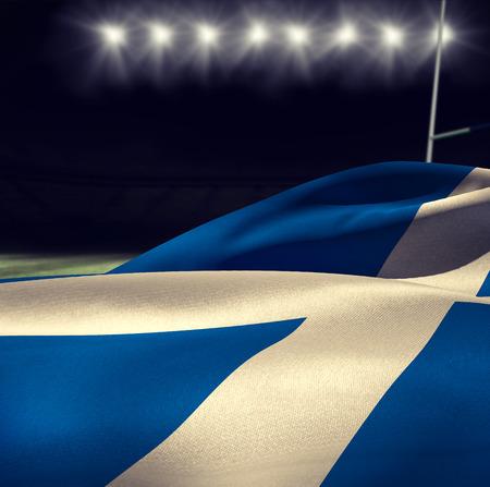 scottish flag: Sventolando la bandiera scozzese contro stadio di rugby