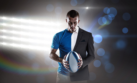 half dressed: Rugby player holding ball against spotlights