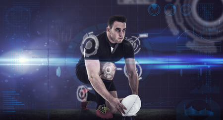 kick ball: Rugby player getting ready to kick ball against fitness interface Stock Photo