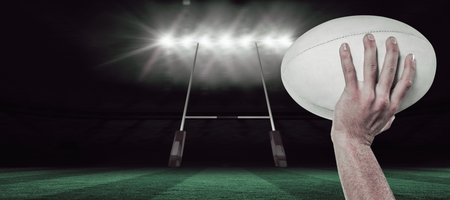 world player: Cropped image of sports player holding ball against rugby stadium