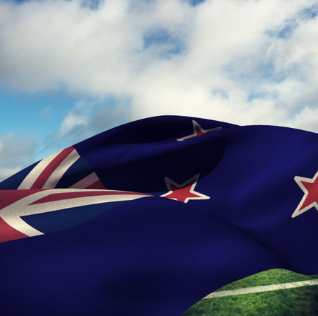 bandera de nueva zelanda: Waving flag of New Zealand against blue sky with clouds